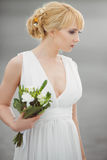 Young beautiful bride with a wedding bouquet. royalty free stock photos