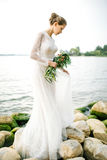 Young beautiful bride in wedding dress near sea Royalty Free Stock Photography