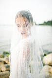 Young beautiful bride in wedding dress near sea Royalty Free Stock Images