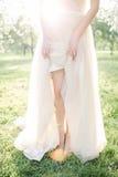 Young beautiful bride in wedding dress in park over sunlightYoun stock photos
