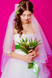 Young beautiful bride in a white dress Royalty Free Stock Photography