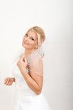 Young beautiful bride in white wedding dress Stock Photos