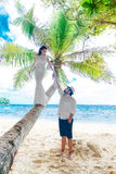 Young beautiful bride in white wedding dress on the palm tree an Royalty Free Stock Photos