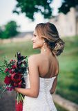 Young beautiful bride. Woman with bouquet of flowers Royalty Free Stock Images