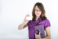 The young beautiful bright girl. With the daily log and the handle wearing spectacles Stock Photography
