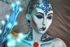 Silver art make up. Young beautiful bright showy girl lady model robotic queen. Fairy tale future party disco techno club. new Art makeup flawless face silver Stock Photos