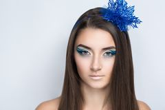Blue make up. Young beautiful bright showy girl lady model snow queen. Fairy tale future party disco club. Art makeup flawless face blue flower accessory, hairdo Stock Images