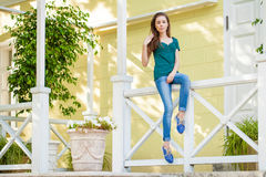 Young beautiful brown haired woman in blue jeans royalty free stock images