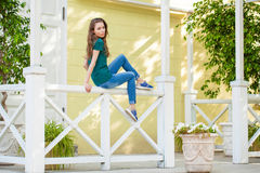 Young beautiful brown haired woman in blue jeans stock image