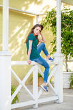 Young beautiful brown haired woman in blue jeans stock photography