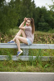 Young beautiful brown haired woman in blue jeans Stock Photo