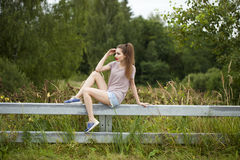 Young beautiful brown haired woman in blue jeans Stock Images