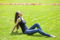 Young beautiful brown haired woman in blue jeans Royalty Free Stock Image