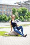 Young beautiful brown haired woman in blue jeans Royalty Free Stock Photography
