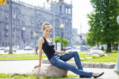Young beautiful brown haired woman in blue jeans Royalty Free Stock Photo