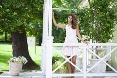 Young beautiful brown haired woman in white dress Stock Photos