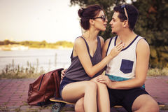 Young beautiful brunette caucasian sexy adult woman and men coup. Young beautiful brunette caucasian sexy adult women and men couple in love on a date outdoors Royalty Free Stock Photography