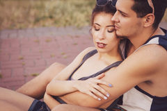 Young beautiful brunette caucasian sexy adult woman and men coup. Young beautiful brunette caucasian sexy adult women and men couple in love on a date outdoors Stock Photos
