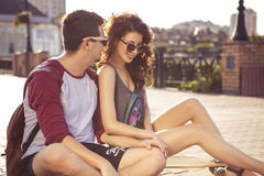 Young beautiful brunette caucasian sexy adult woman and men coup. Young beautiful brunette caucasian sexy adult women and men couple in love on a date outdoors Stock Photo