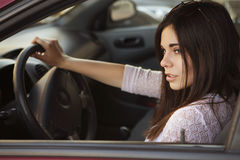 Young beautiful brunette caucasian woman  driving a red car. sum Stock Photography