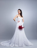 A young brunette woman in a white bridal dress Stock Photos