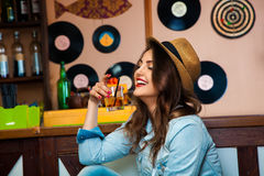 Young beautiful brunette drink cocktail and having fun in bar Stock Images