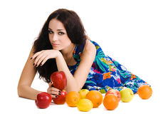 Young beautiful brunette with fresh fruits Stock Photography