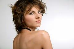 Young beautiful brunette girl. In bikini on white background Stock Photo