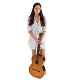 Young beautiful brunette girl with acoustic guitar. Young beautiful brunette girl in white chemise with acoustic guitar stock photo