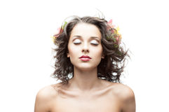 Young beautiful brunette girl with blowing hair. Portrait of young attractive caucasian brunette girl with blowing hair and softly closed eyes Royalty Free Stock Photo