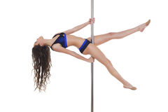 Young beautiful brunette girl doing pole dancing exercise Stock Image