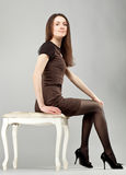 Young beautiful brunette girl in dress Stock Images