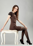 Young beautiful brunette girl in dress Stock Image