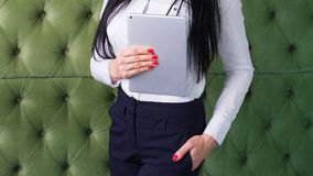 Young beautiful brunette girl holding a tablet royalty free stock photography