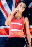 Young beautiful brunette girl posing with a British flag in autumn park Royalty Free Stock Photos