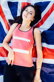 Young beautiful brunette girl posing with a British flag in autumn park. Young beautiful brunette girl posing with a British flag in sunny autumn park Stock Image