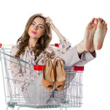 Young beautiful brunette girl sitting in an empty shopping troll Royalty Free Stock Photo