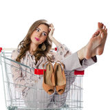 Young beautiful brunette girl sitting in an empty shopping troll Stock Images