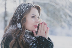 Free Young Beautiful Brunette Girl Warms His Hands In The Cold Stock Image - 80089231