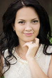 Young beautiful brunette with a gold ring with onyx royalty free stock photo