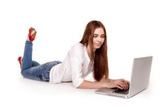 Young beautiful brunette having online shopping, lying down,  looking up - Stock Images