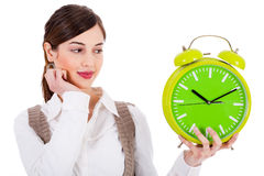 Young beautiful brunette holding the clock Stock Photos