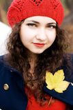 Young beautiful brunette in a knit beret and a coat Royalty Free Stock Photography