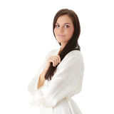 Young beautiful brunette in peignoir Royalty Free Stock Photos