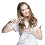 Young beautiful brunette pours water Stock Photo