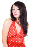 The young beautiful brunette in a red dress. Royalty Free Stock Images