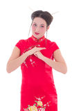 Young beautiful brunette in red japanese dress isolated on white Stock Images