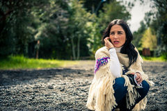Young beautiful brunette speaking on the phone at winter beach. Young beautiful brunette on the phone at winter beach Royalty Free Stock Photos