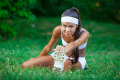 Young beautiful brunette sportswoman outdoor Royalty Free Stock Image