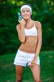 Young beautiful brunette sportswoman outdoor Stock Image